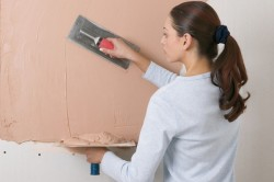 Выравнивание и оштукатуривание стен